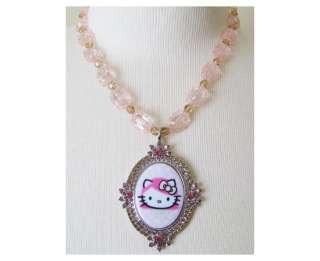 TARINA TARANTINO HELLO KITTY PINK HEAD Pink Lucite Portrait Necklace