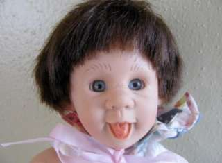 Baby Doll with Sticking Out Tongue