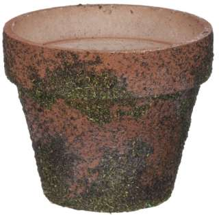 moss covered flower pot makes a beautiful addition to any garden