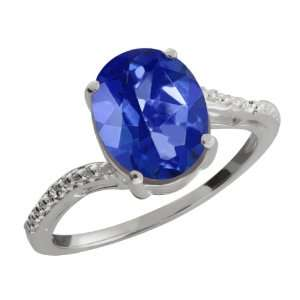 61 Ct Oval Blue Sapphire Mystic Topaz and Diamond 10k White Gold Ring