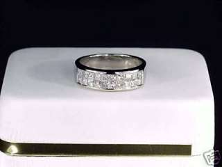 18KT LADIES INVISIBLE SET PRINCESS CUT DIAMOND RING
