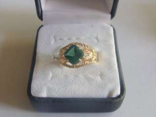 on a Beautiful 10K Yellow Gold Ring with a Helenite Center stone