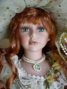 18 IN.PORCELAIN DOLL MADONNA GOLD SPECKLE GREEN DRESS