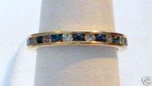 SAPPHIRE BLUE & CLEAR CRYSTAL GOLD TONE ETERNITY BAND