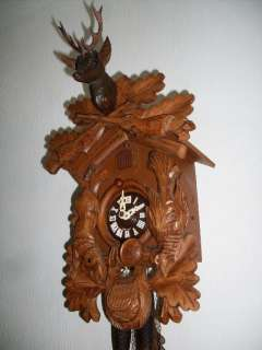 condition, all hand carved wood, horn and deer in wood, no glue